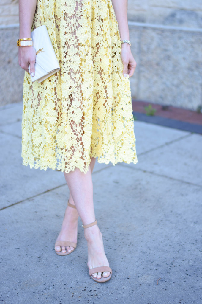 yellow lace dress, white clutch