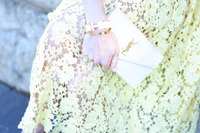 yellow lace dress, white clutch