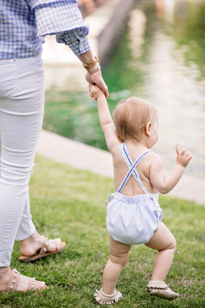 baby walking to lake
