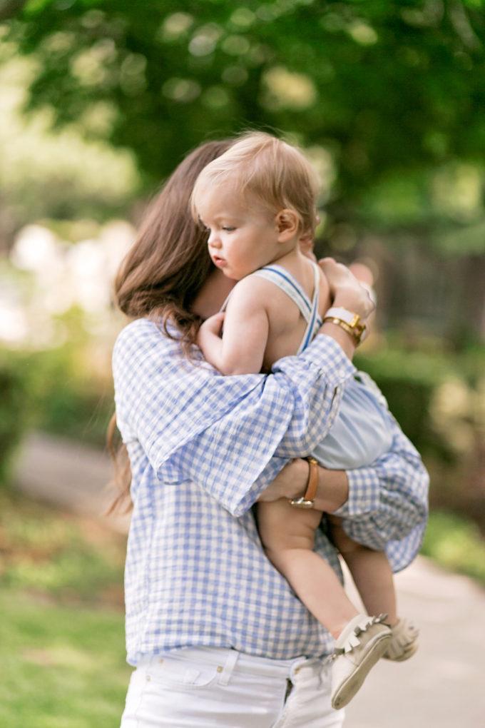 baby boy hugging mother