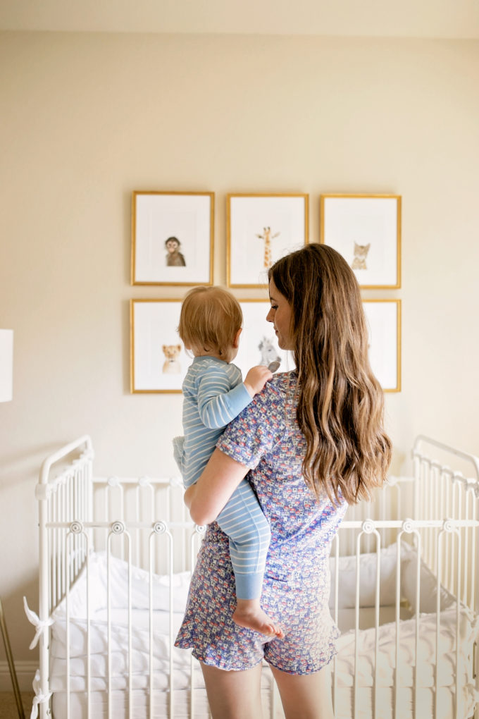 baby and mom looking at animal pictures on wall