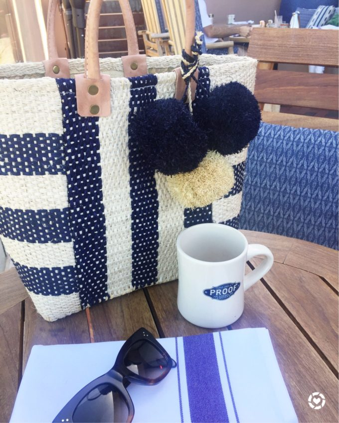 straw tote bag with pom poms