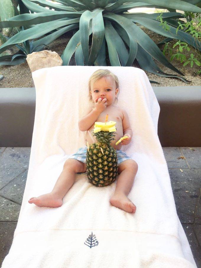 baby on lounge with a pineapple