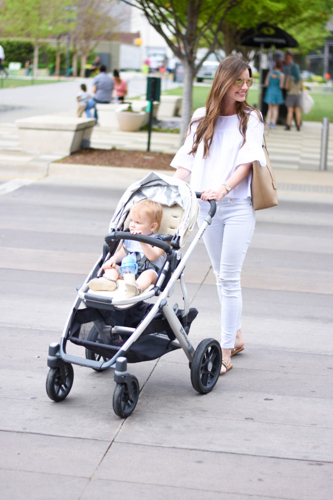 mom pushing baby stroller across street
