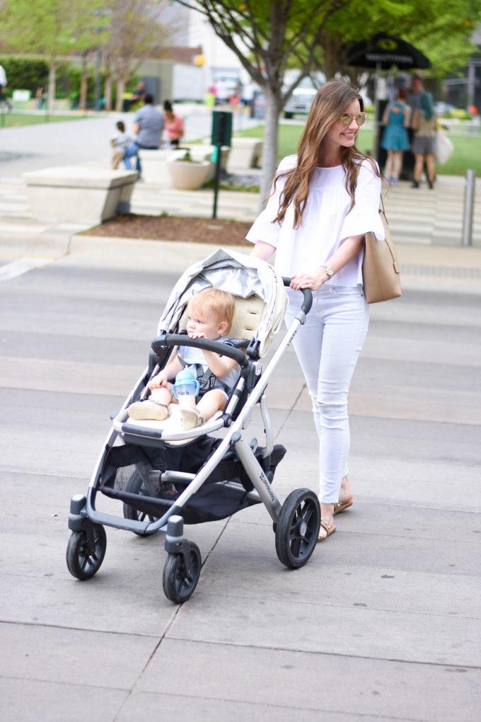 mom pushing baby stroller across street
