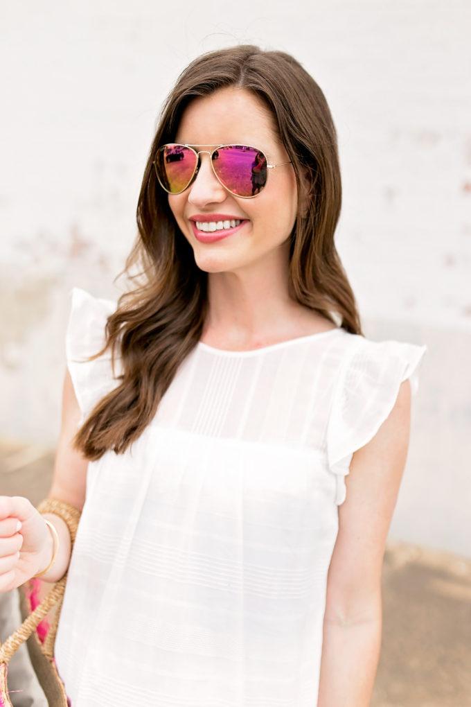 white dress, pink mirrored sunglasses