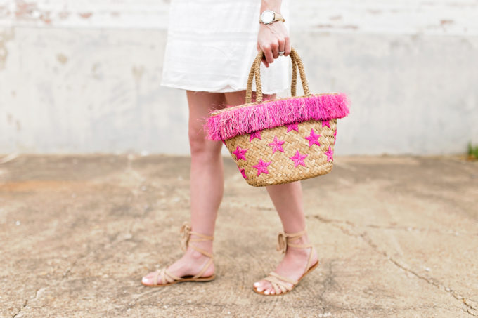 straw tote bag with hot pink stars and fringe