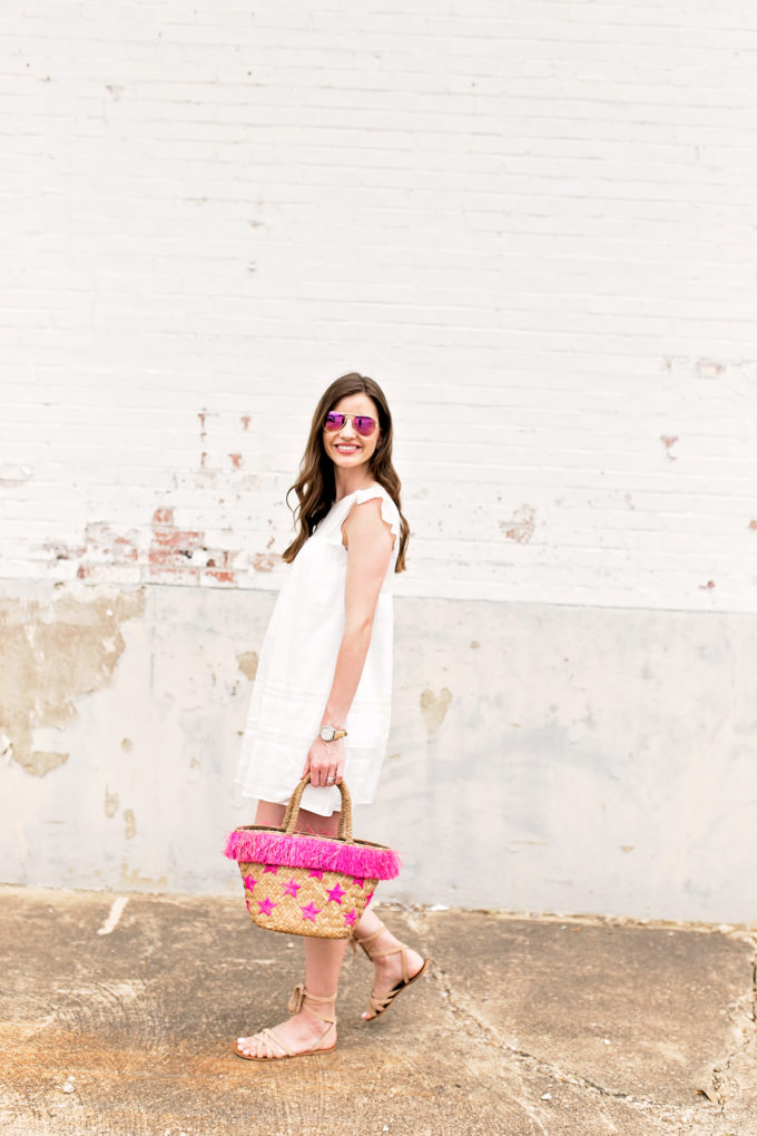 little white dress with straw tote bag