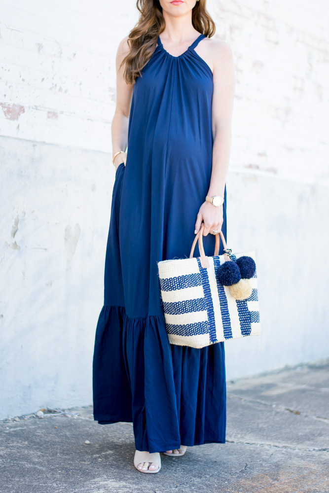 navy maxi dress with ruffle hem, striped tote bag