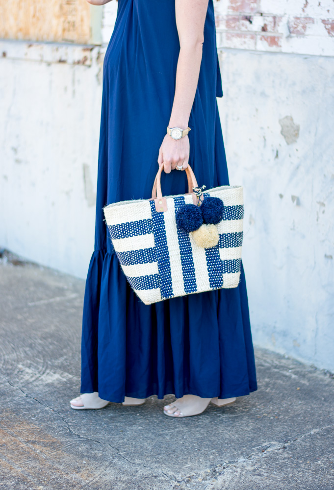 navy maxi dress, striped straw tote bag