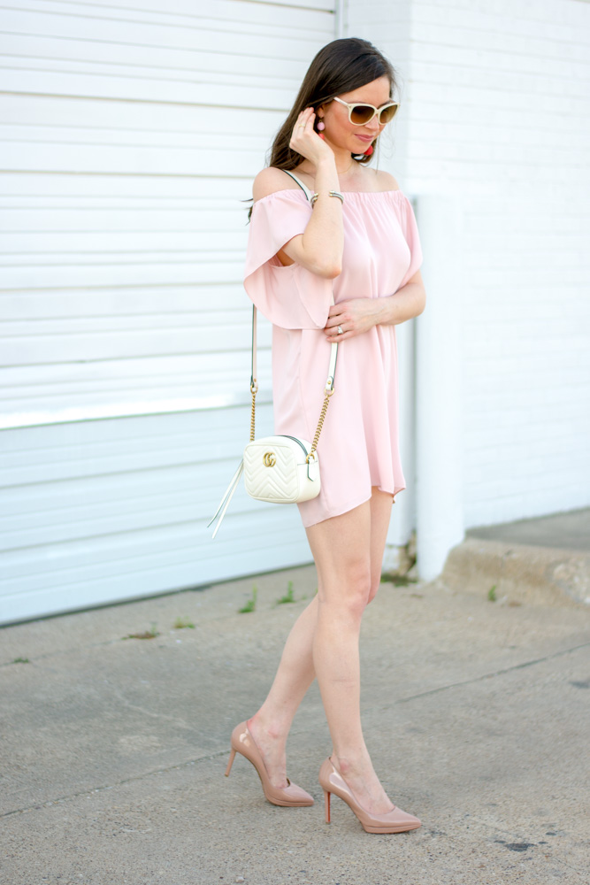 pink mini dress, white crossbody bag