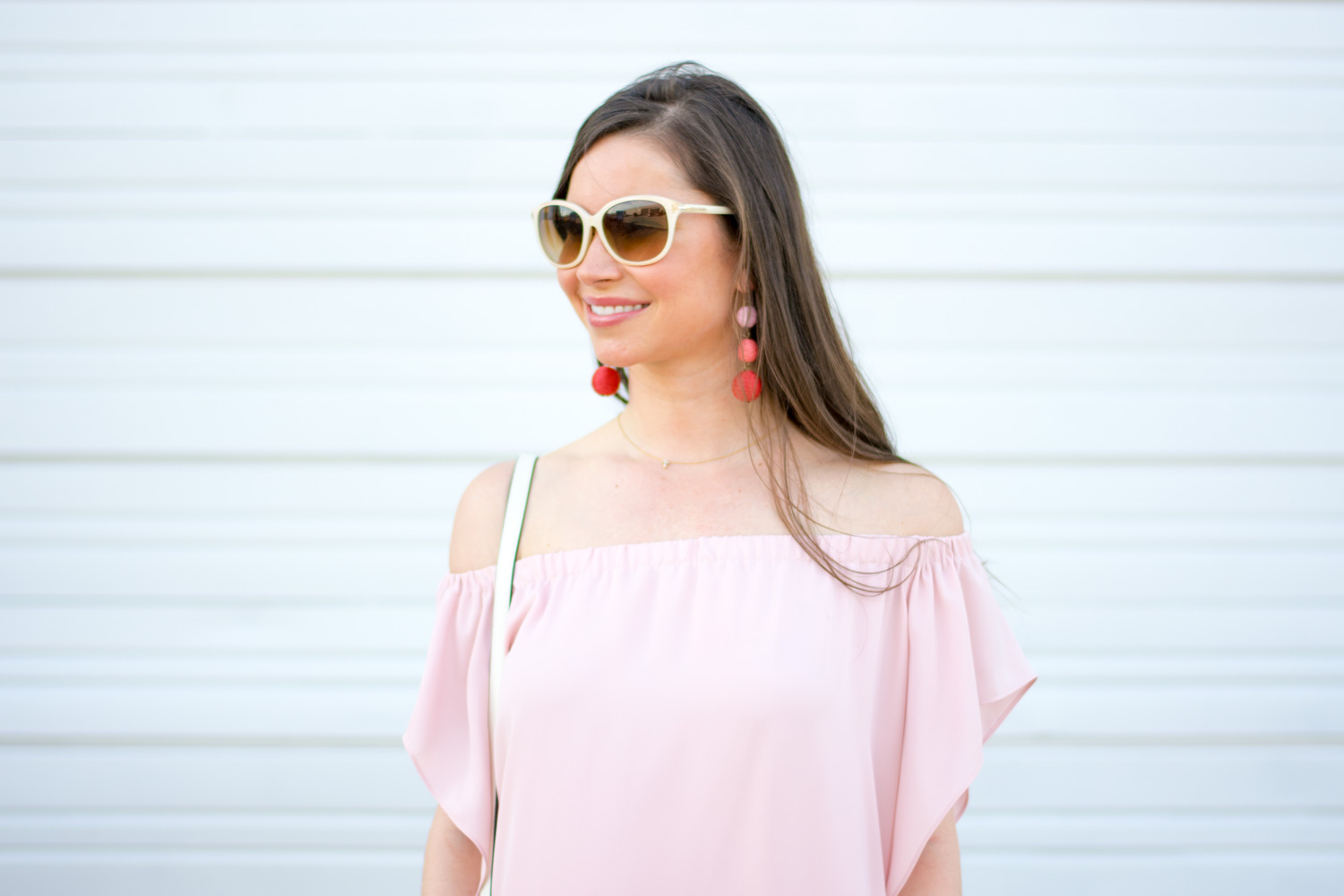 pink top, white sunglasses