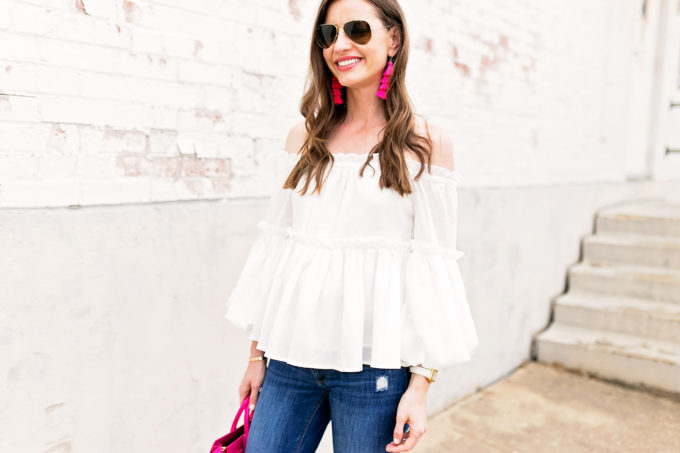 white off the shoulder top, hot pink statement earrings