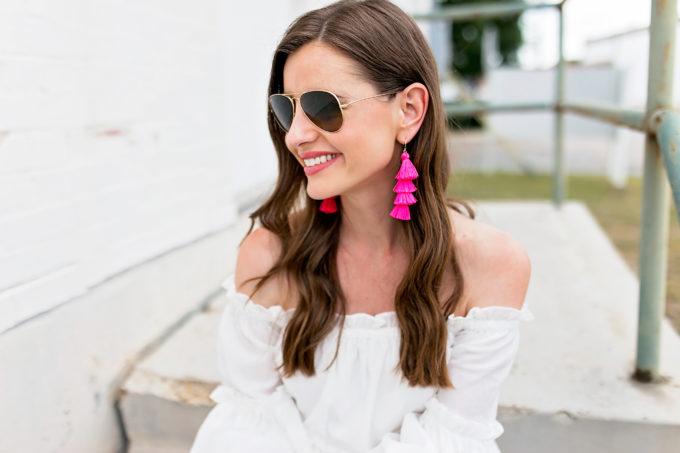 white off shoulder top hot pink fringe earrings