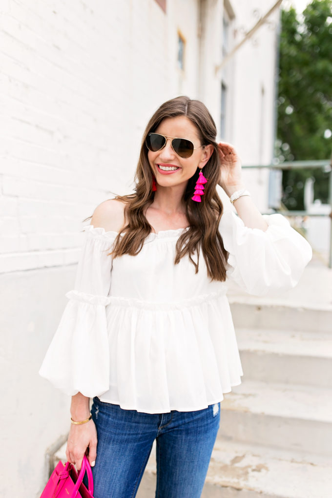 white off the shoulder top pink fringe earrings