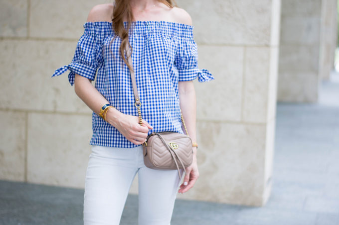 blue and white gingham top. tan cross body