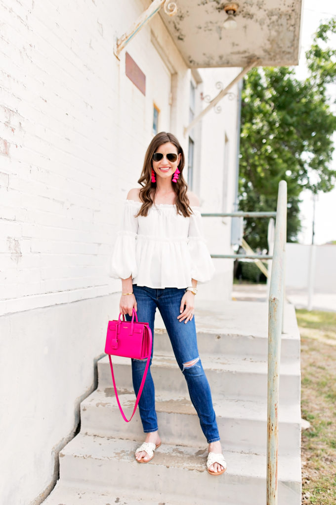 white ruffle off the shoulder top, hot pink handbag