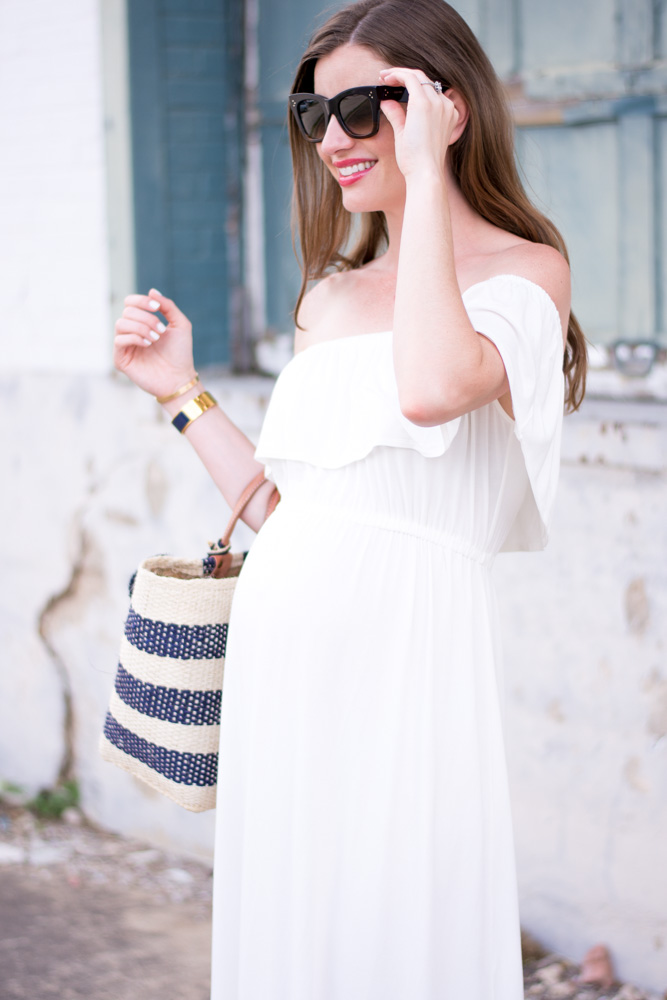 white off the shoulder maternity dress navy and white straw tote bag