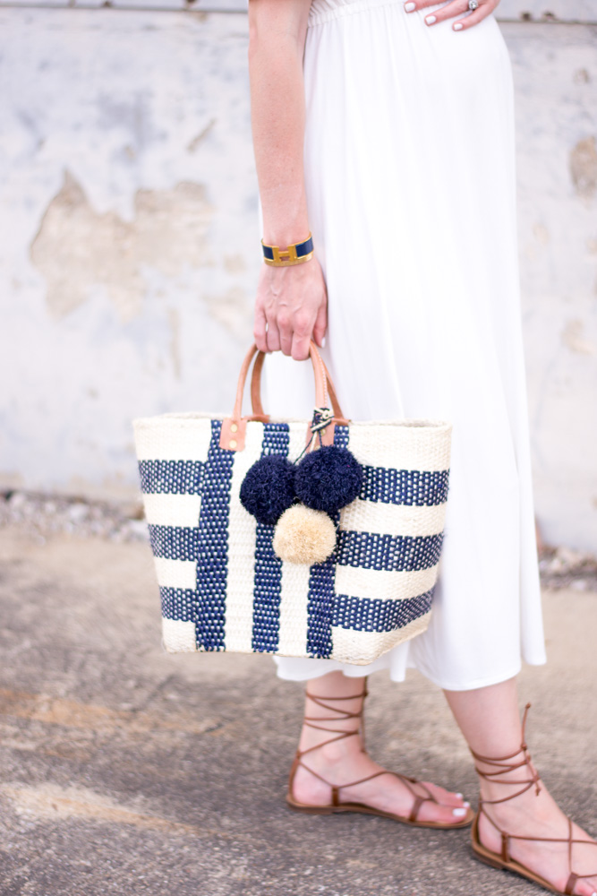 navy and white straw tote bag