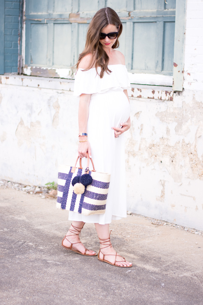 white off the shoulder maternity maxi dress straw tote bag