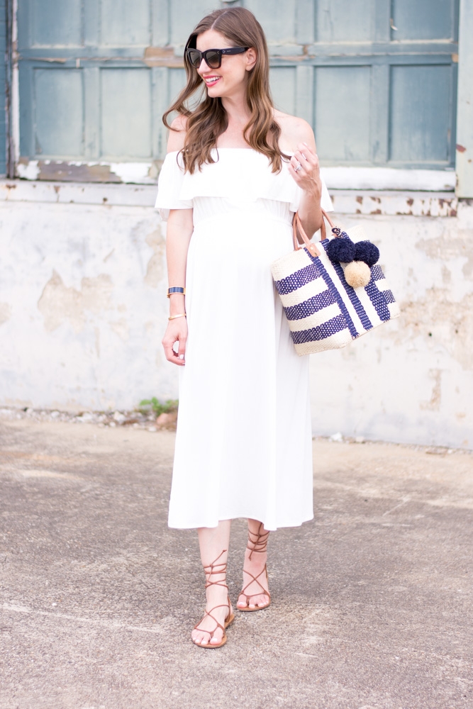 28 week bumpdate white off the shoulder maternity maxi dress navy and white straw tote bag
