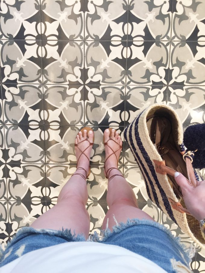 lace up sandals on a tile floor