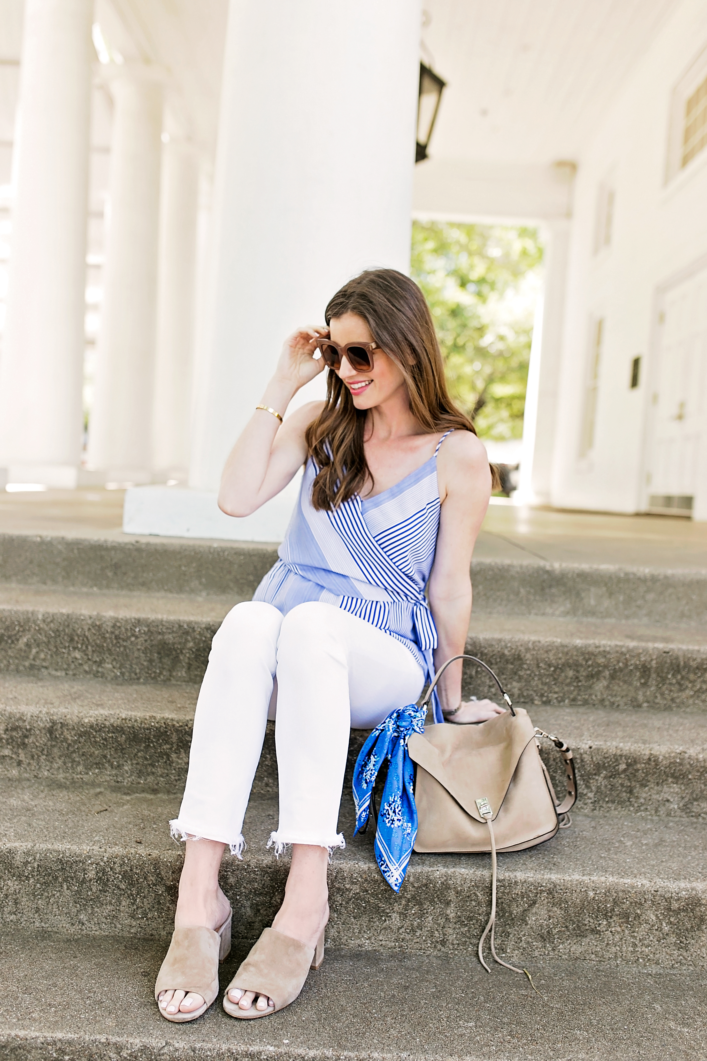striped wrap front menswear inspired camisole top white jeans tan suede tote bag with scarf tied on