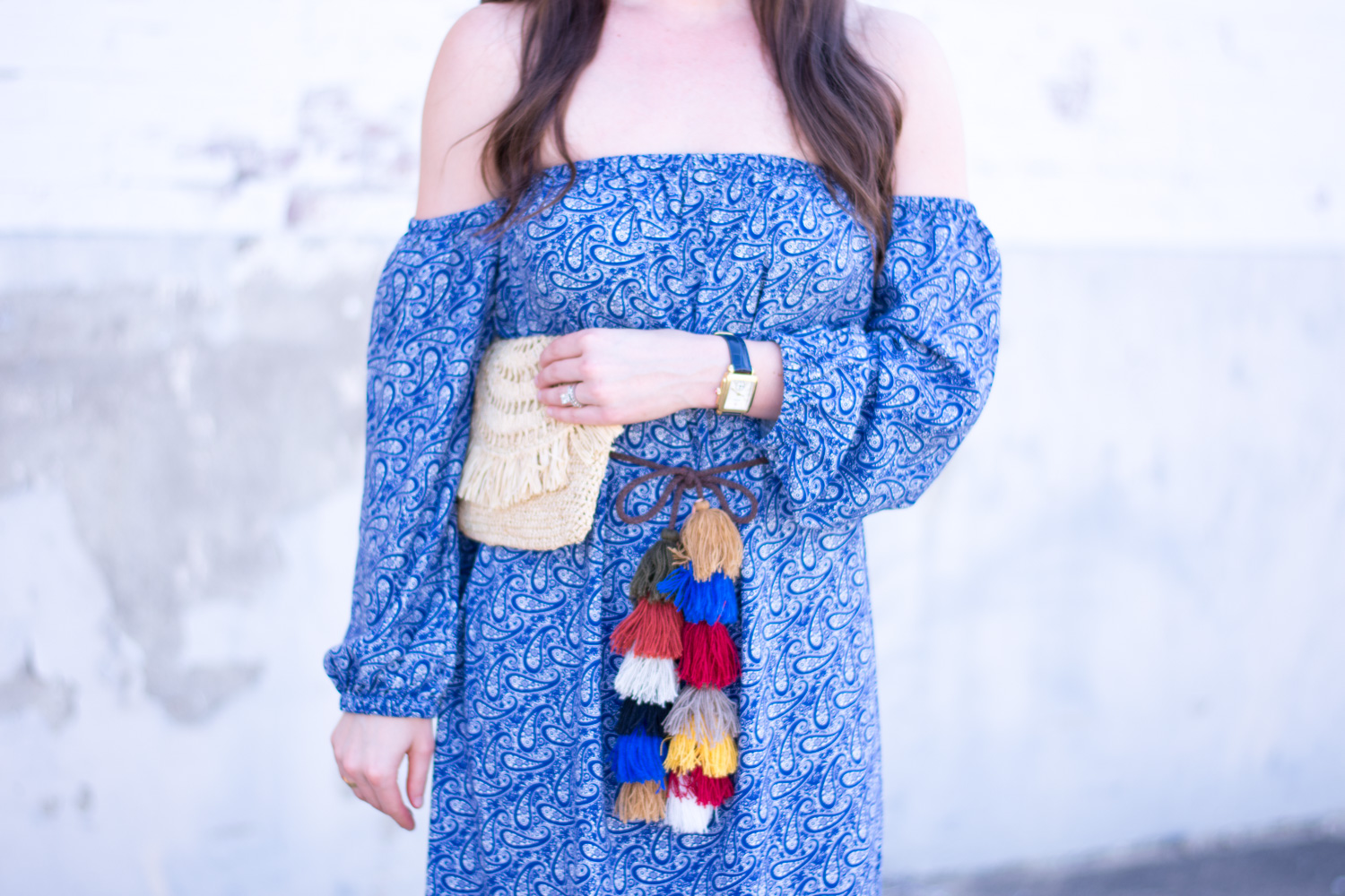 off the shoulder dress, straw clutch, tassel belt