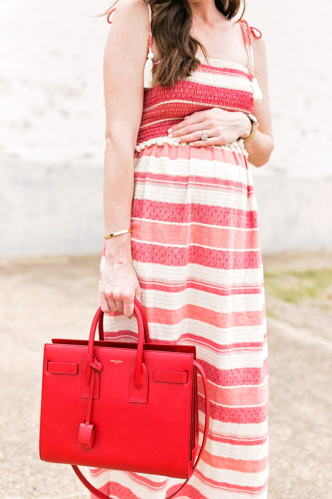 red and white maternity maxi dress, red handbag