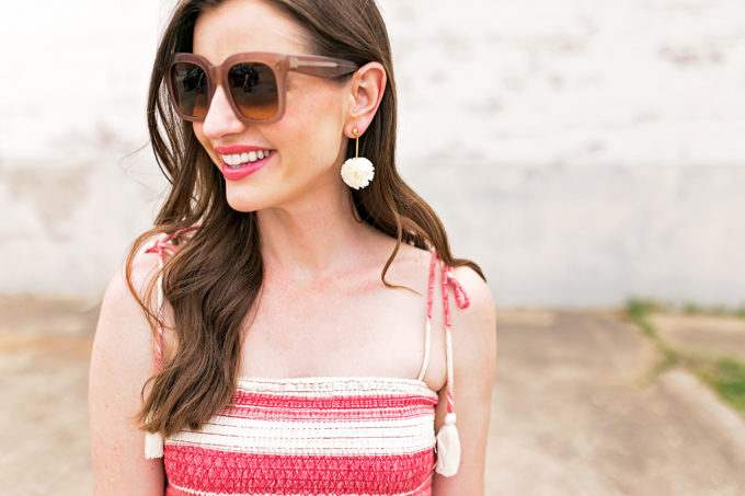 oversized blush sunglasses pom pom earirngs