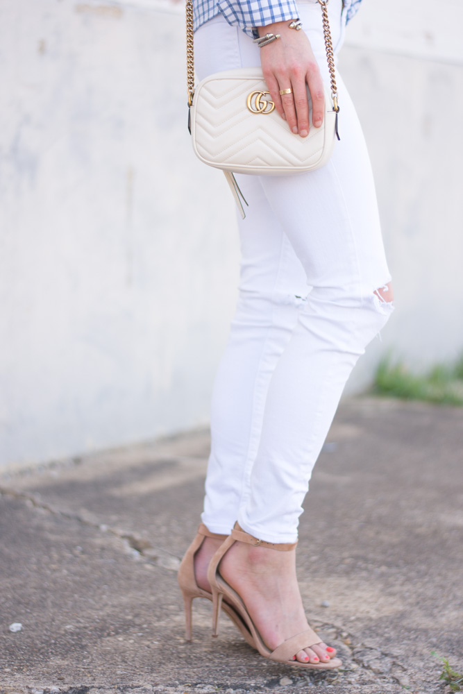 white distressed jeans, white shoulder bag