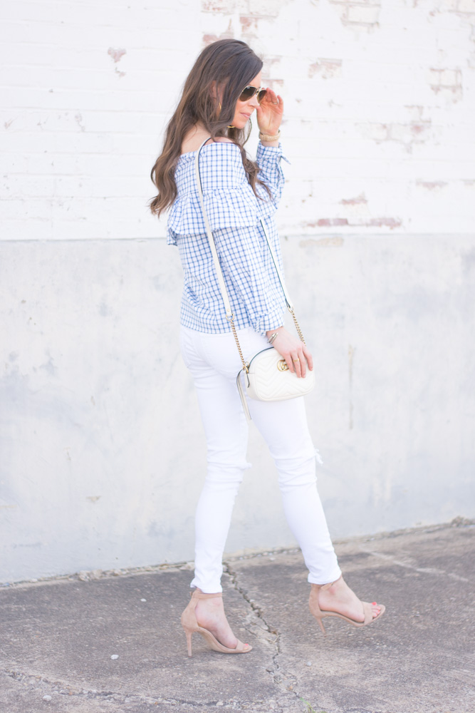 ruffle neck top white jeans white shoulder bag