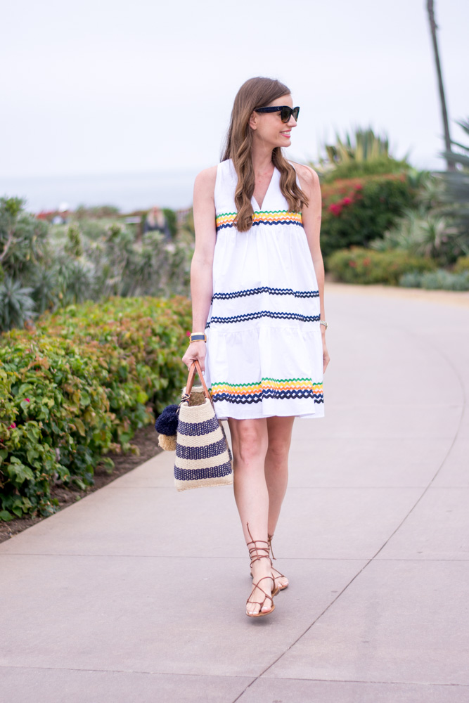 white ric rac dress navy and white straw tote