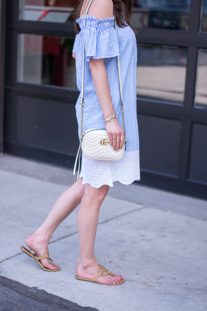 off the shoulder dress with eyelet trim and gucci handbag