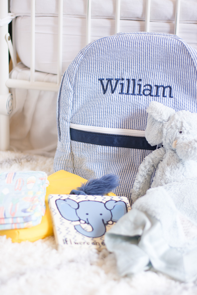 baby boy's backpack with personalization baby blanket and stuffed elephant