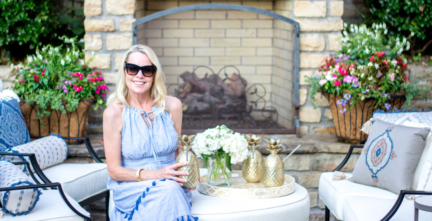 woman sitting by outdoor fireplace