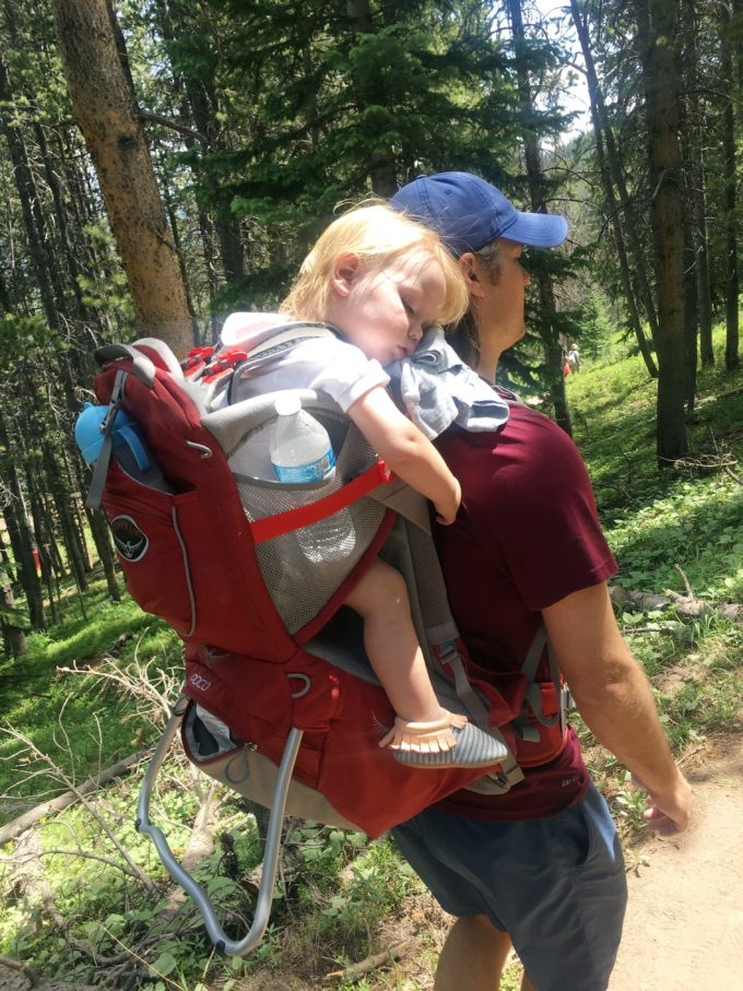 baby sleeping in backpack on a hike in vail