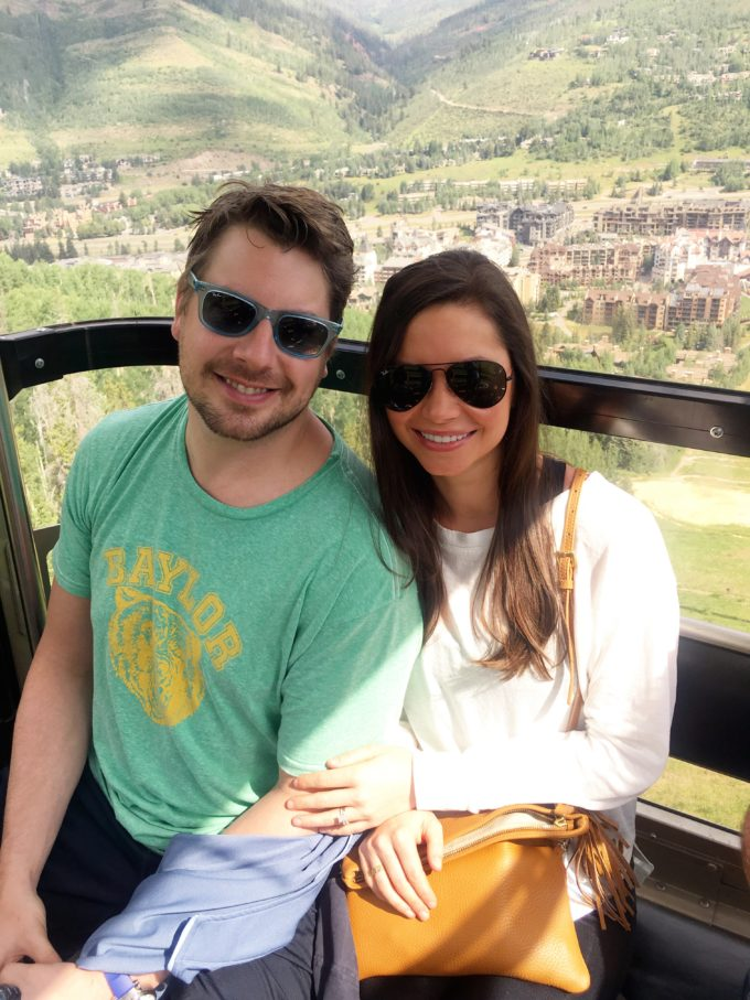 couple riding gondola at vail