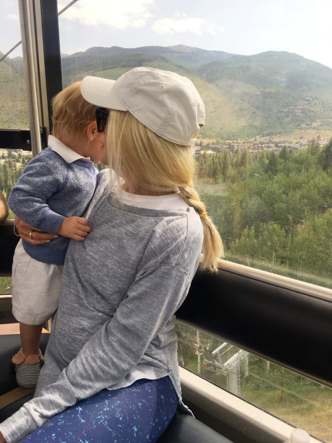 woman and baby boy riding gondola at vail