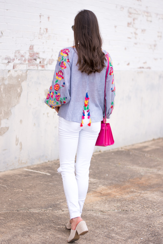 embroidered top with tassel detail white jeans hot pink bag