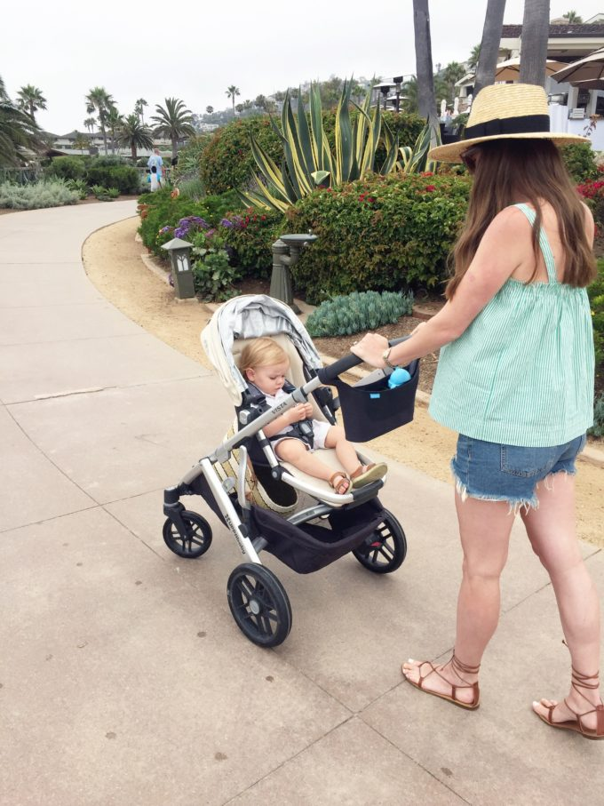 woman walking stroller with baby