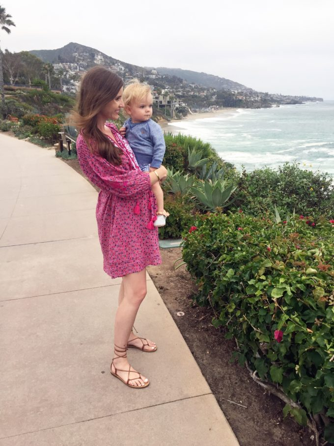 mom and baby boy looking at ocean view from montage laguna beach