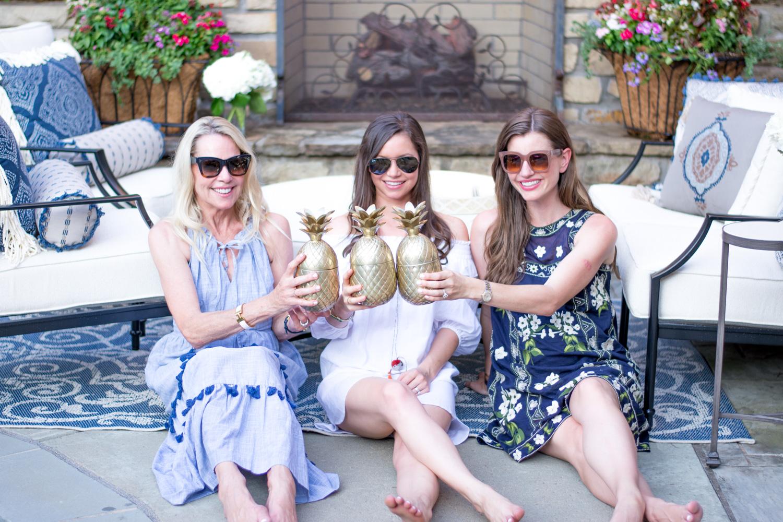 three ladies stting on aptio with golden pineapple drink tumblers