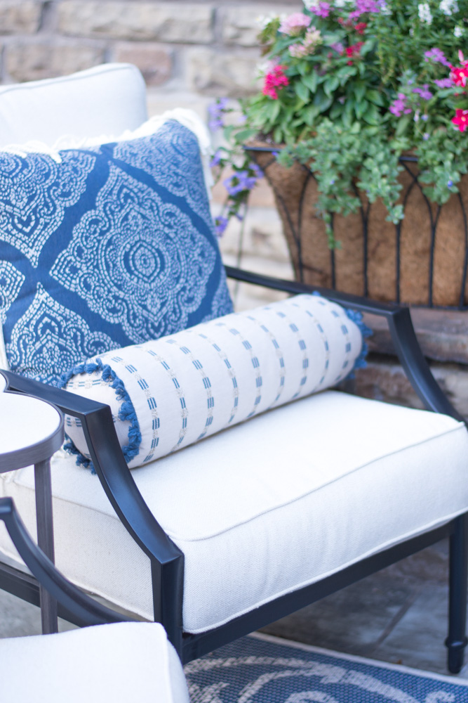 outdoor lounge chair with blue print pillow