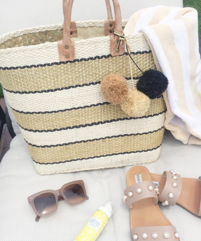 straw tote pearl embellished sandals neutral sunglasses