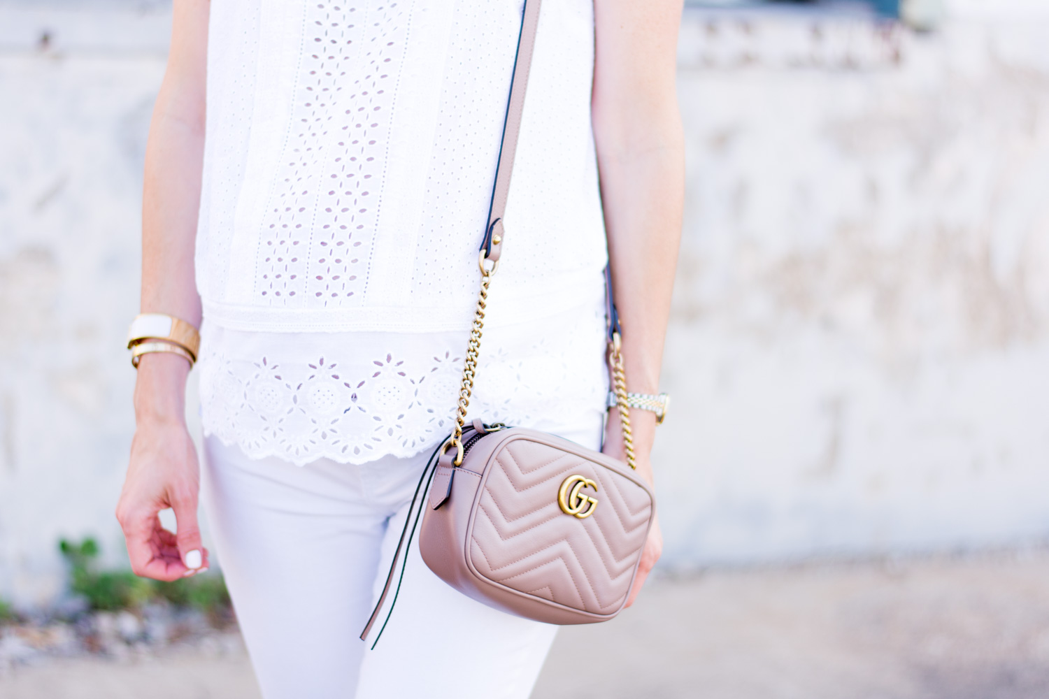 white eyelet top with blush pink handbag