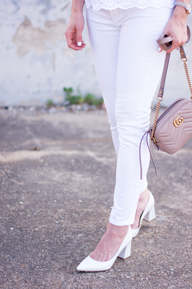 white jeans with a blush pink handbag and white pumps