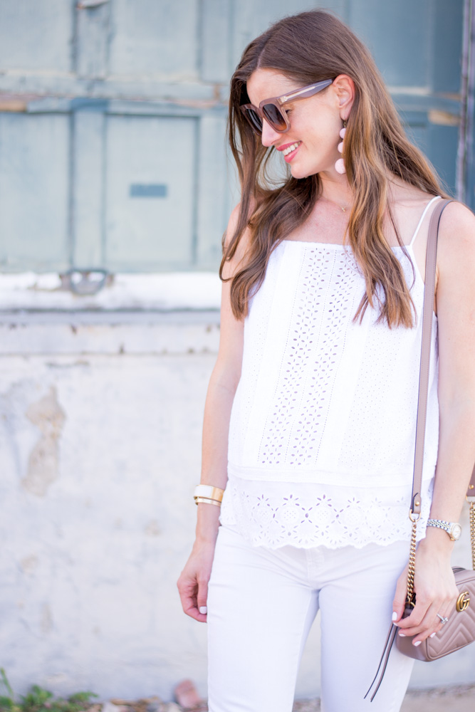 white eyelet top with white jeans and white pumps