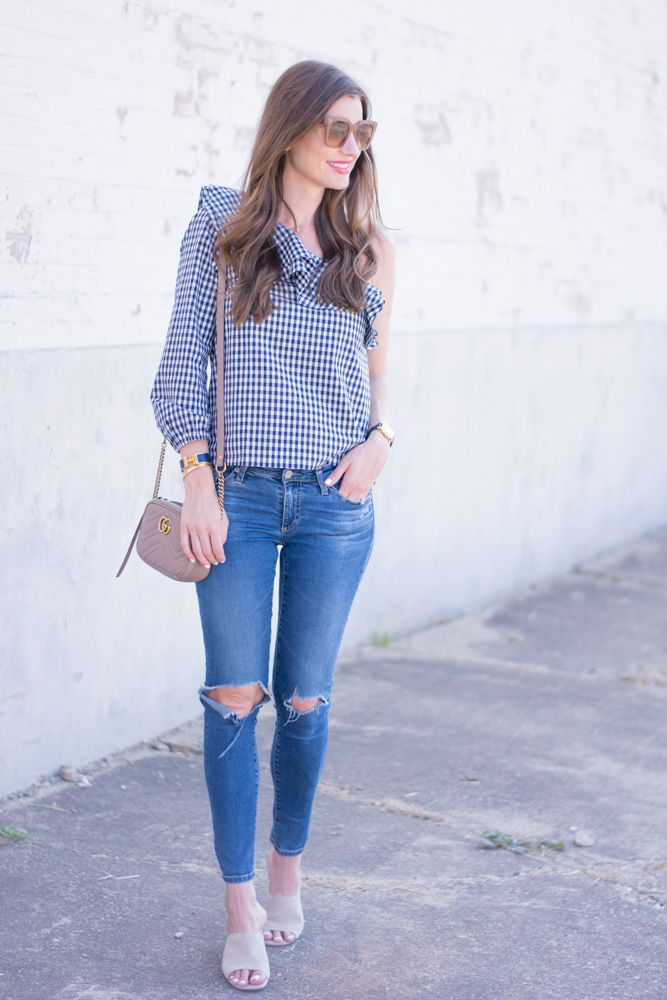 ruffle neck gingham top with distressed jeans nude handbag and mules
