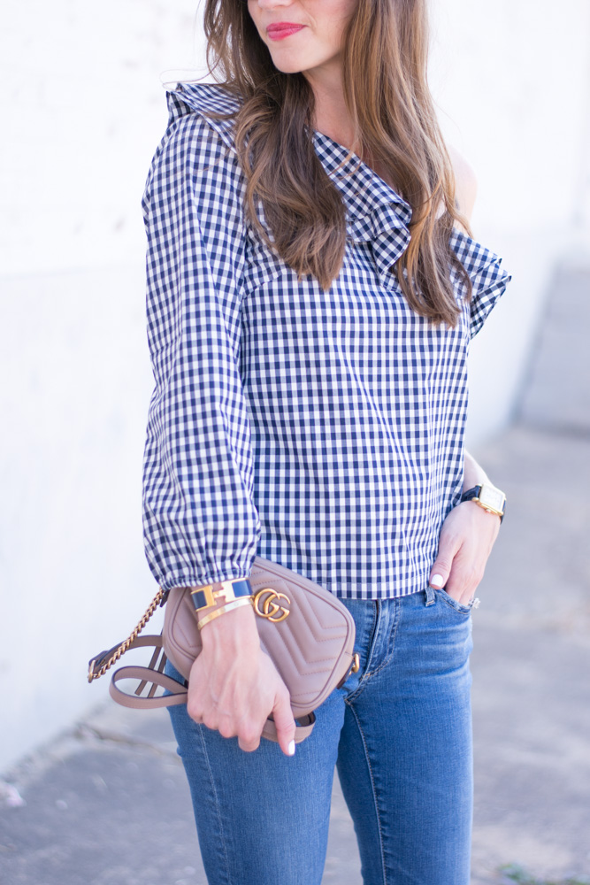 gingham top with ruffle, nude camera bag